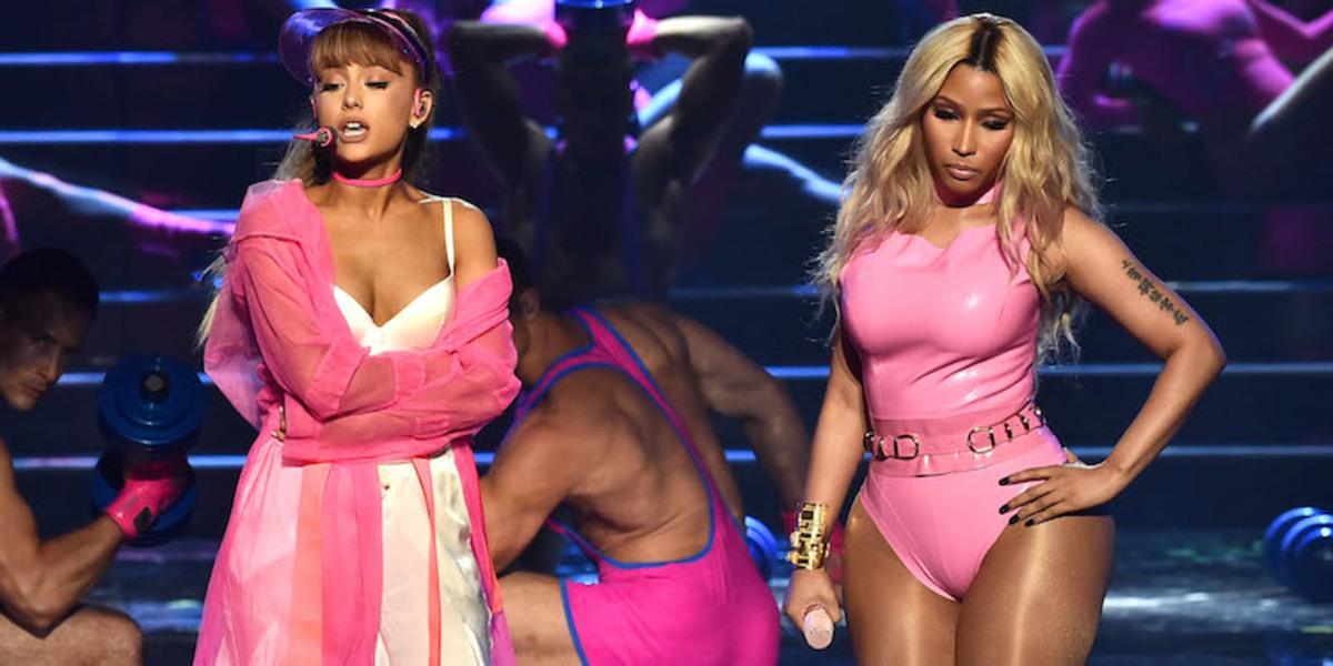"Ariana Grande and Nicki Minaj perform ""Side to Side"" on a stage themed around a gym."