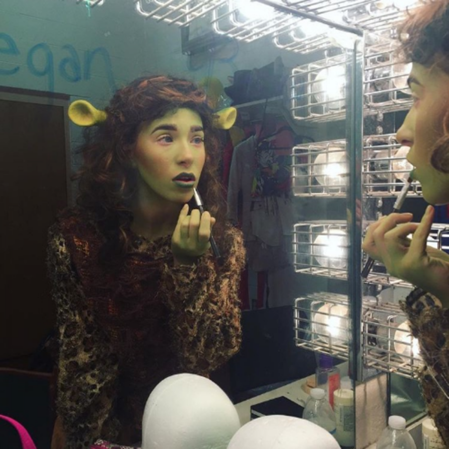 Theatre junior Skyler Sajewski applies stage makeup to portray the character Mama Ogre in Shrek: The Musical. During her sophomore year, Sajewski was cast as Mama Ogre and understudy to Fiona, one of the primary protagonists in the play.