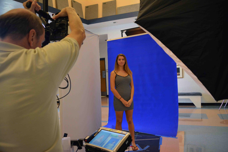 Dance junior Lauren Clair poses to get her yearbook photo taken in the lobby of Meyer Hall.