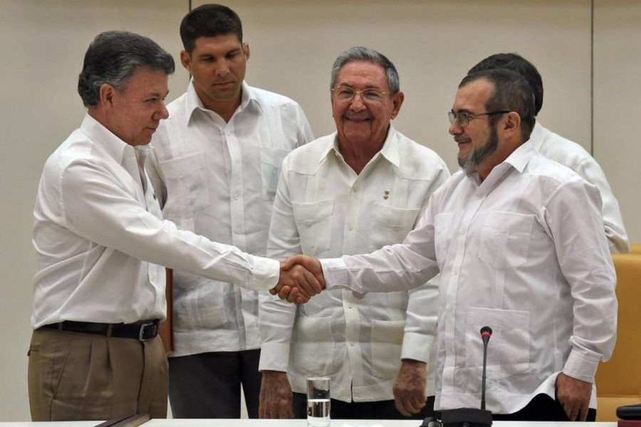 Colombian President Juan Manuel Santos and leaders of FARC agree to a historic peace deal with mediation from Cuba. The peace deal ends more than five decades of conflict.