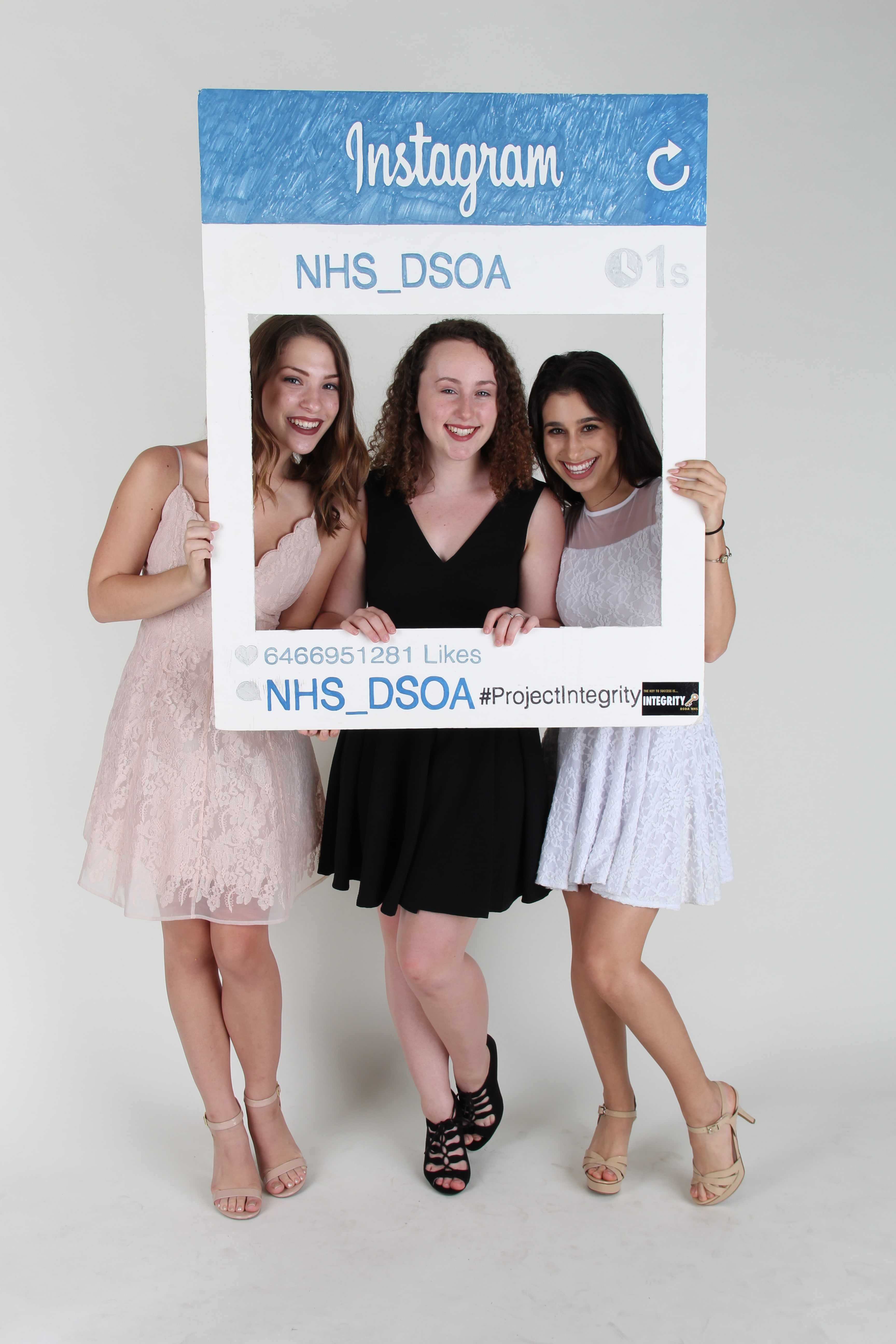 Posing for a photo, theater juniors (L-R) Skyler Sajewski, Aleah Beche, and Zoey Burger celebrate their induction into the National Honor Society on Sept. 30.