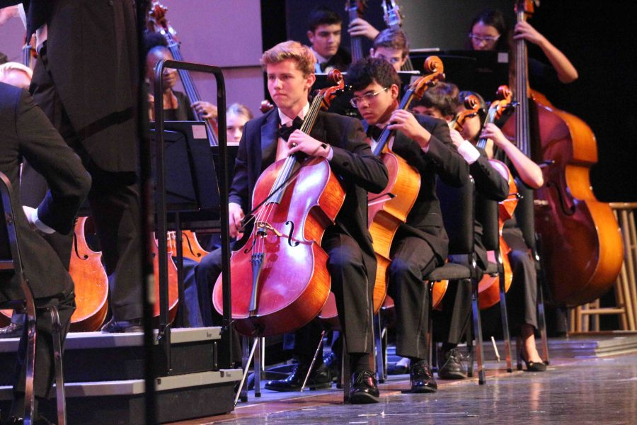 """Strings junior Dillon McCormick and strings senior Jorge Plaza play the cello during Beethoven's """"Symphony No. 3 in Eroica."""""""