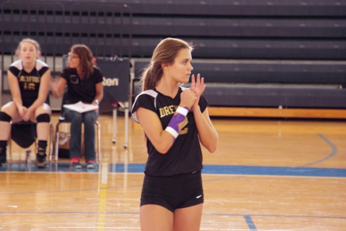 Communications junior Chantel McMillan warms up with the Dreyfoos team for their home game against Forest Hill High School on Sept. 8. McMillan has had to work against a torn ligament in her hand this season but will not let the injury stop her from competing with her team.