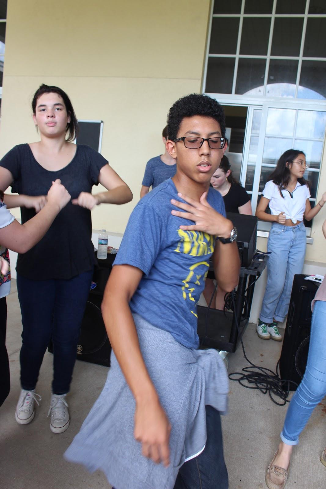 "Band junior Samuel Calzada dances to the music provided by the Latin Hispanic Heritage club.  Club member Catalina Correa said, ""The LHHC fiestas are always fun and a good way for people to get a taste of what we're all about."""