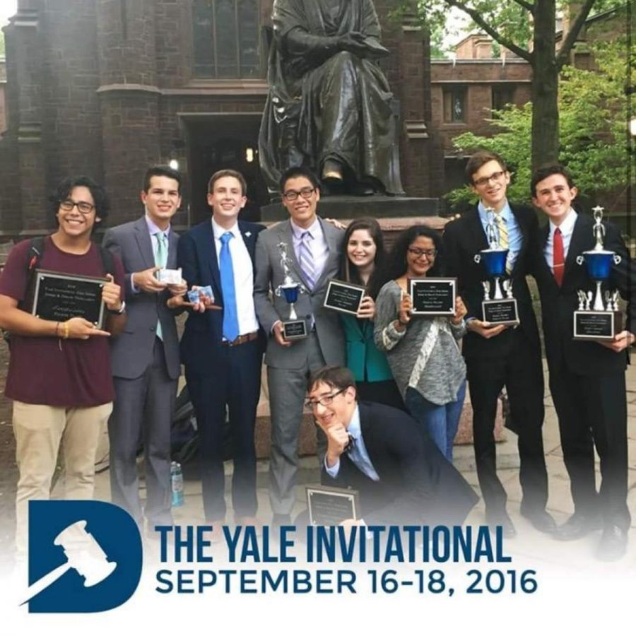 Social studies teacher (L-R) Javier Mora, communications sophomore Michael Bole, former vocal sophomore Luke Tillitski, communications senior Jack Yan, junior Maya Levkovitz, senior Anjelica Abraham, senior Matt Nadel, junior Alexander Gordon, and digital junior Joshua Meredith pose with their awards. The Dreyfoos debate team competed at the Yale Invitational and placed fourth in tournament sweepstakes in New Haven, Connecticut.