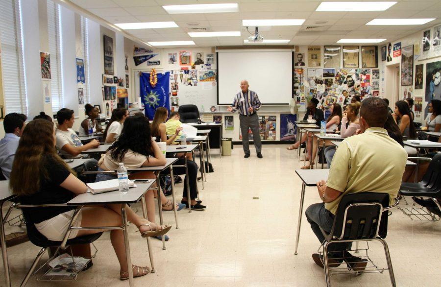Social studies teacher Jeffrey Stohr and his students listen to former Congress member, Mark Foley.