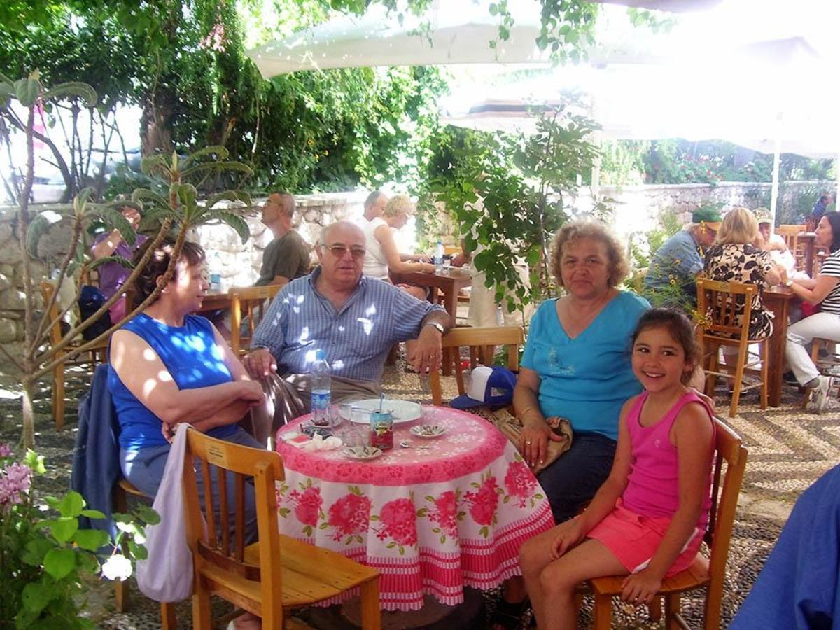 Communications junior Ruby Rosenthal (right) sits with her grandmother and family friends in Çeşme, Turkey in June 2007. Rosenthal has been visiting Turkey since 2001, and was granted a dual citizenship in the same year.