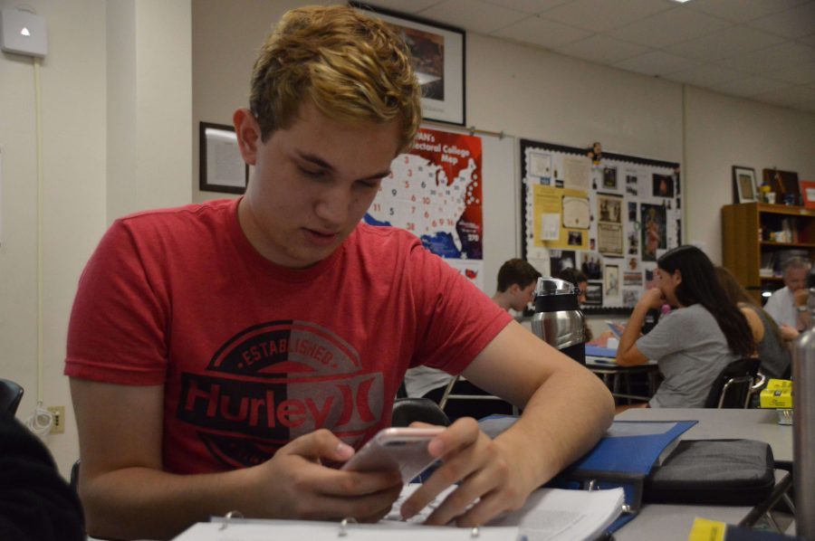 Vocal senior Noah Gunn casts his vote in The Muse's school wide mock election poll for Issue 2.