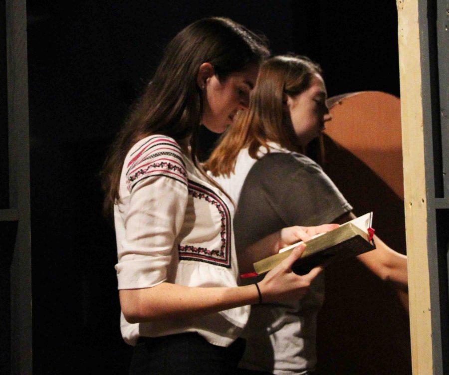 (L-R) Theatre junior Sidney Rubinowicz and theatre senior Cami Wright work on The Addams Family set. The show runs Oct. 28th through Nov. 6th.