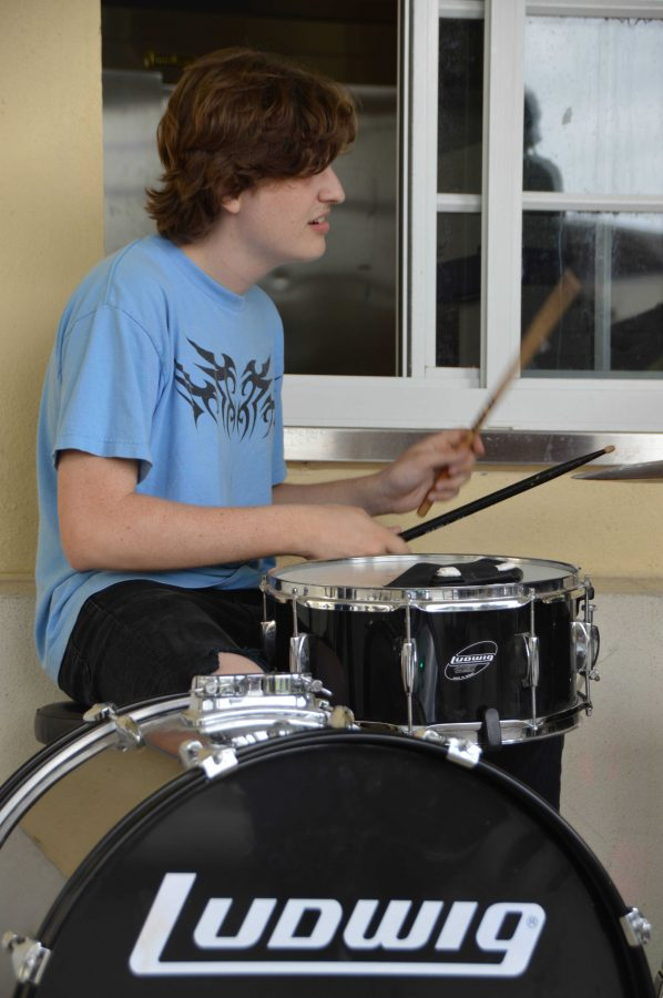 Theatre senior Ben Rothschild plays the drums as Dreyfoos' club, The Collective, performs at lunch to celebrate International Women's Day.