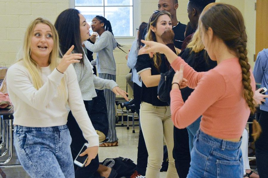 (L-R) Dance senior Miranda Capparelli and junior Madelynn Gallo dance and sing along to music at the Fun Friday event hosted in the cafeteria by SGA.