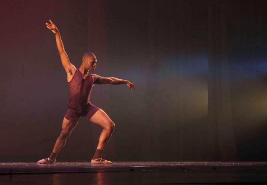 Dance senior Darius Hickman performs during the dress rehearsal of the Fall Dance Concert.