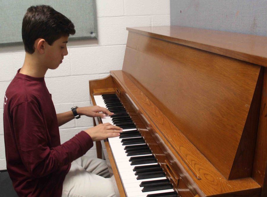 Piano sophomore Griffin Miller practices piano for Prism, which takes place Nov. 30 at the Kravis Center.