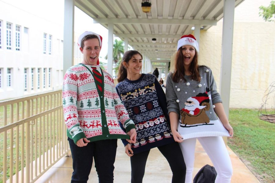 Vocal+senior+Jared+Freedland%2C+piano+senior+Christina+Harbaugh%2C+and+communications+senior+Hannah+Dunn+show+off+their+holiday+sweaters+for+Ugly+Sweater+Day.