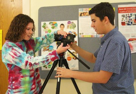 Communications freshmen Taylor DiPietro and Sebastian Fernandez work on a film during 4th period.
