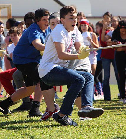 The freshman tug of war team pulls against the junior team.