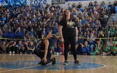 """Belting out the lyrics to Adele's """"Skyfall"""", theatre senior Sarah Joseph (L-R) and vocal senior Makayla Forgione represented their class in the karaoke competition at today's pep rally. The seniors won first place in karaoke."""