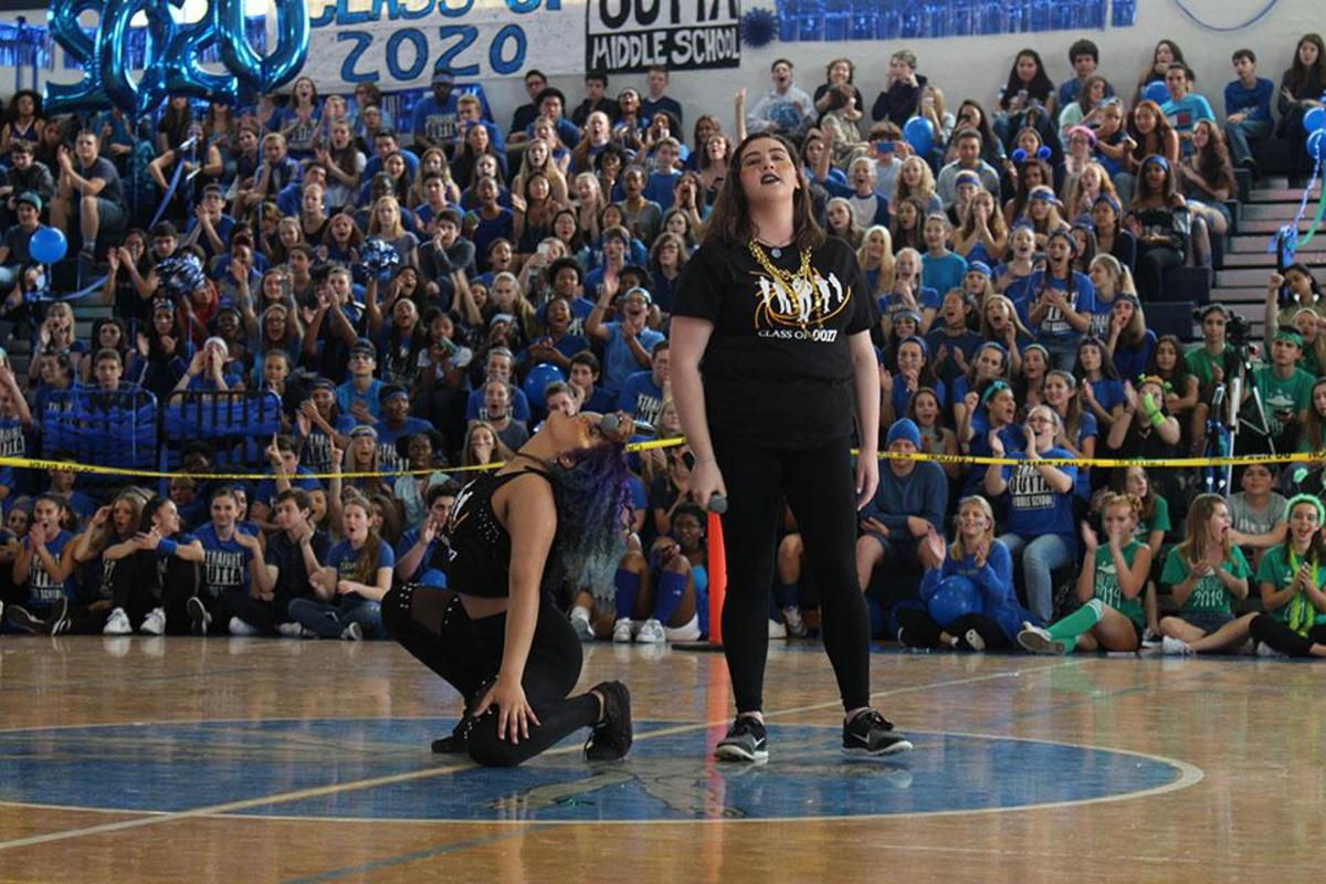"Belting out the lyrics to Adele's ""Skyfall"", theatre senior Sarah Joseph (L-R) and vocal senior Makayla Forgione represented their class in the karaoke competition at today's pep rally. The seniors won first place in karaoke."