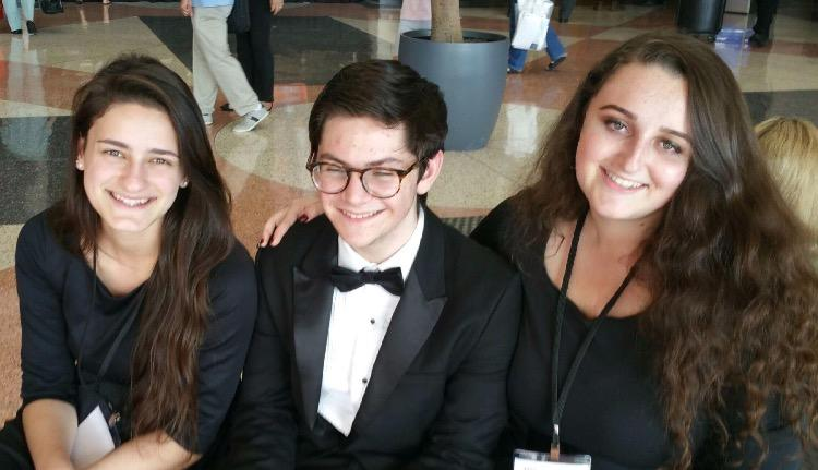 During the day of the Philharmonic orchestra performance, band junior Chloe Tordi (L-R), senior Harrison Cody, and junior Rachel Gebeloff dress in their performance attire for All-State.
