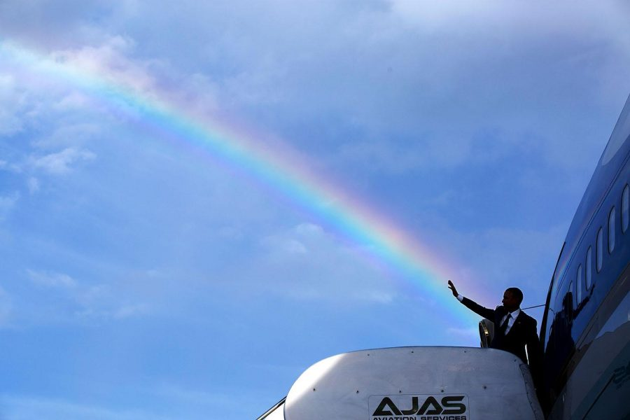 President Barack Obama gives a wave as he boards Air Force One prior to departure from Kingston, Jamaica on April 9, 2015.