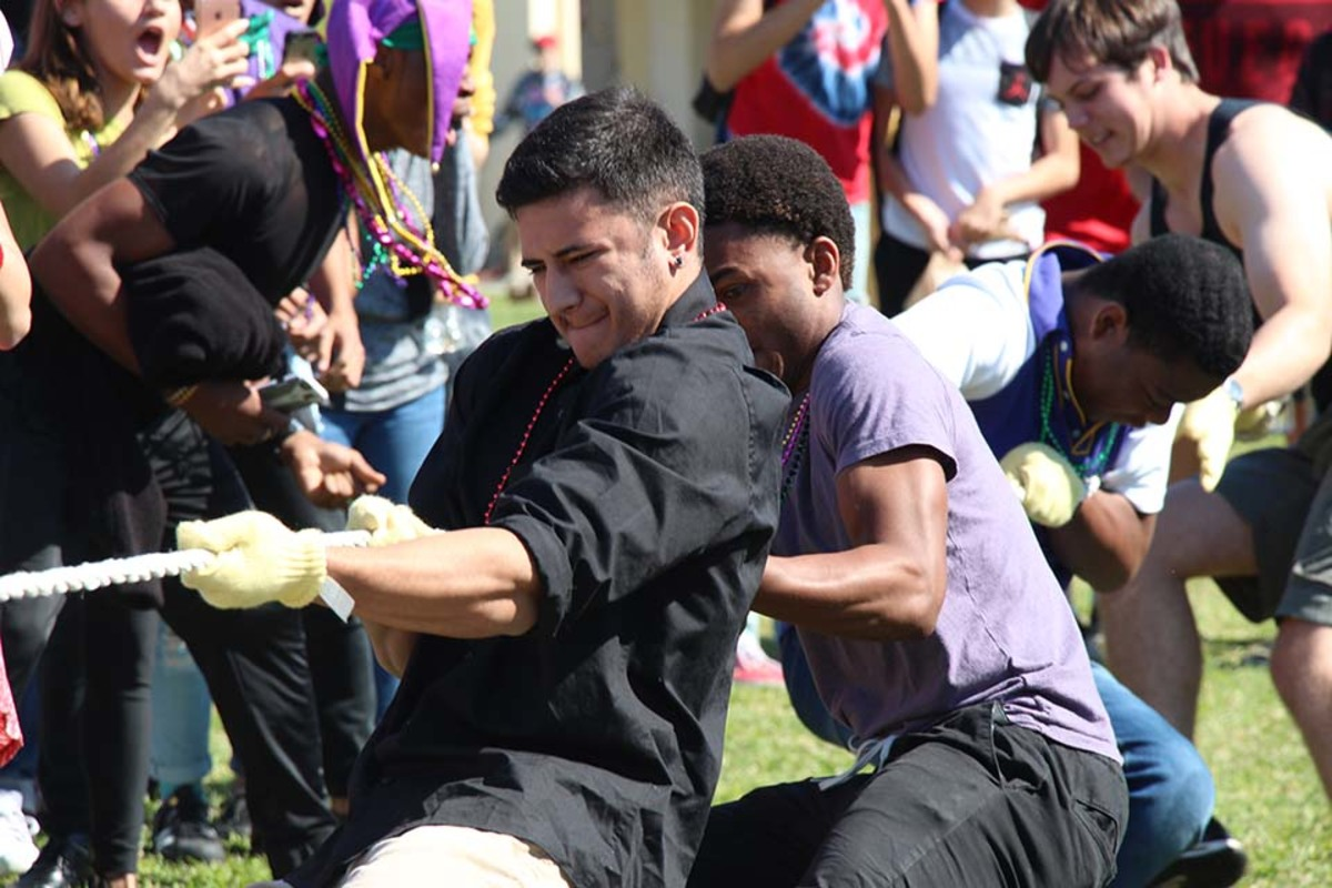 Communications senior Makoa Beck pulled his team to victory in tug-of-war. Six volunteers from each grade competed in rounds of tug-of-war each pulling the rope to the best of their abilities. There were four rounds; in the first round, juniors advanced over the freshmen, and in the second round, seniors defeated the sophomores. In the third-place match,the freshmen lost to the sophomores, and in the final round, seniors competed against juniors, and lost.