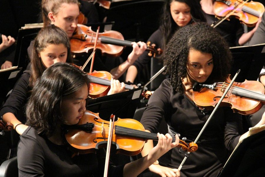 Strings freshmen Hannah Xie (left) and Abigail McNutt perform in the String Orchestra concert held on Feb. 17 in the Brandt Black Box Theater.