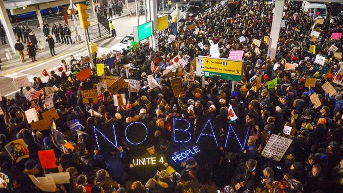 Thousands of protesters gathered at JFK airport in New York City on Saturday in protest of people detained under Trump's executive order Friday.