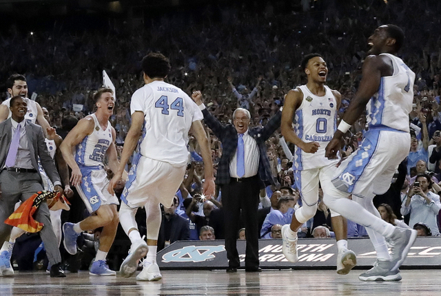 North Carolina head coach Roy Williams and players celebrate after the finals of the Final Four NCAA college basketball tournament against Gonzaga, Monday, April 3, 2017, in Glendale, Ariz. North Carolina won 71-65.