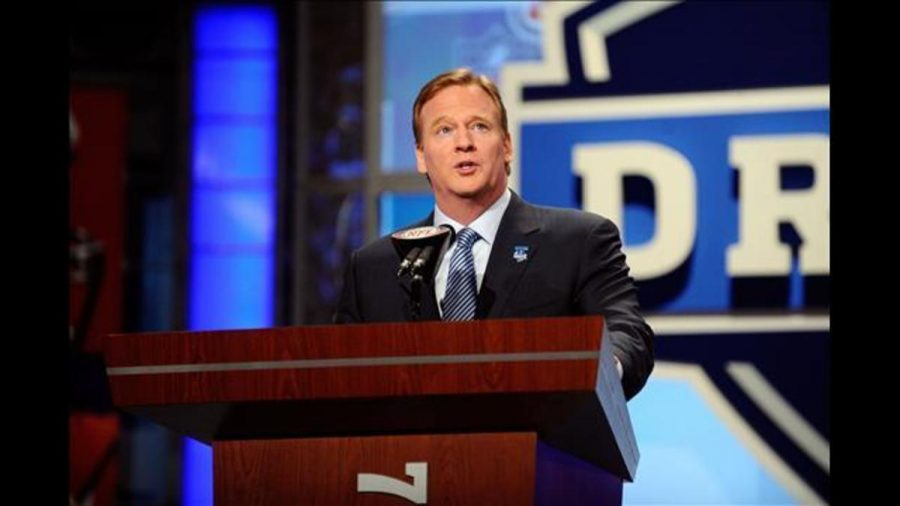 NFL Commissioner Roger Goodell prepares to announce the opening selection in the 2010 draft. The draft this year will take place in Philadelphia, Pennsylvania and for the first time the opening round will be announced outdoors.