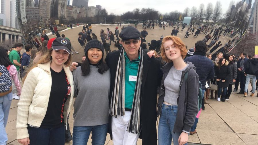 (L-R) Strings sophomore Hayley Huber, Miajoy Daorerk, strings director Wendell Simmons, and strings sophomore Leah Winters pose in front of The Bean at Chicago.