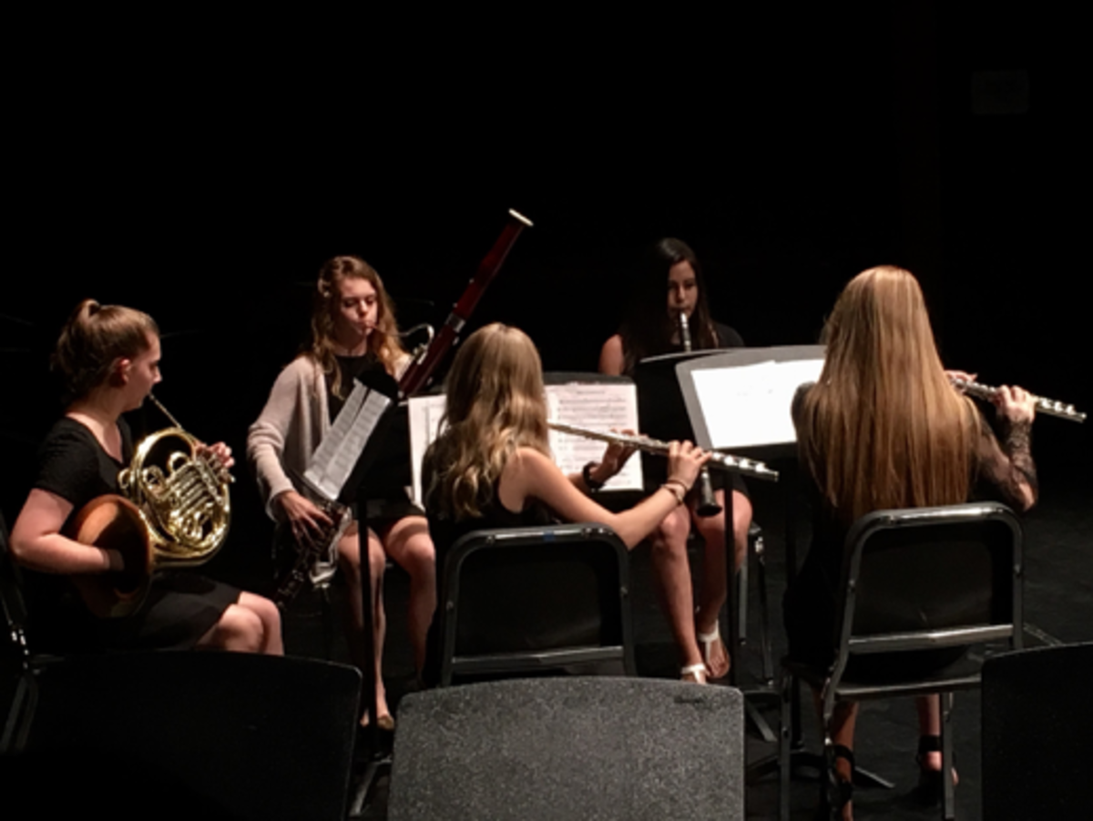 "The wind quintet performed ""Movements for Wind Quintet, Op. 16"" composed by Robert Muczynski. Featuring whimsical and light-hearted melodies, students performed for friends and peers."