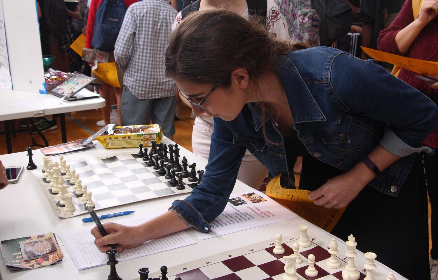 Vocal sophomore Jackie Kaskel signs up for Chess Club at Club Rush. Students had the opportunity to learn more about all 78 of Dreyfoos' clubs at the event.