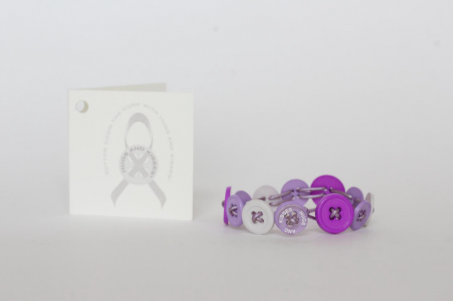 Hugs and Kisses bracelets (pictured) are available in a variety of colors and styles, and at least one button on each includes the name of the organization.
