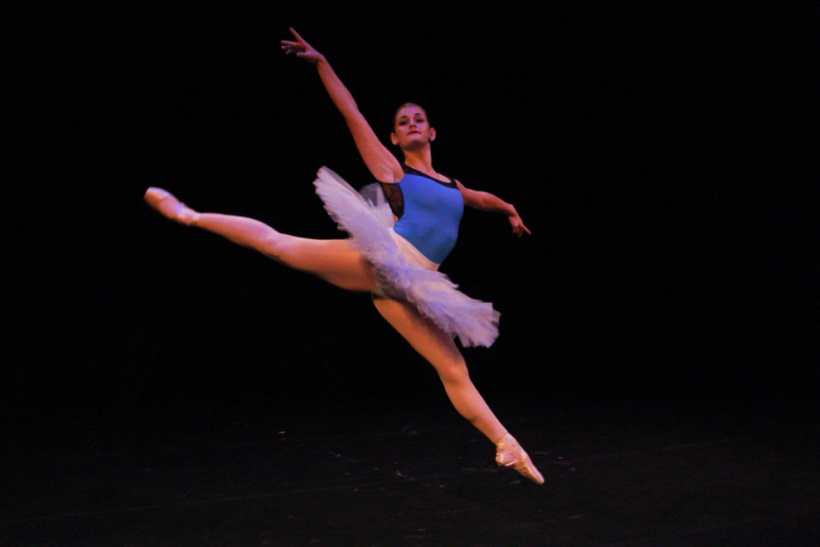 """Dance senior Allison Cavanagh performs her solo: Peasant Pas Variation, choreographed by dance dean Heather Lescaille. Cavanagh's solo showcased techniques from the French ballet, """"Giselle."""""""