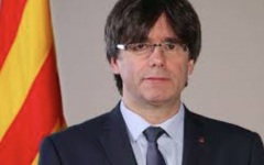 Disgraced Catalonian leader Carles Puigdemont poses for a photo before he is ousted from office.