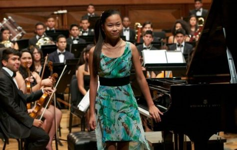Piano junior Alessandra Fang stands to be recognized after performing along with a live orchestra. Fang was chosen to travel to Venezuela in 2014 to showcase her talent.