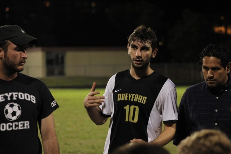 Communications+senior+and+boys%E2%80%99+soccer+team+captain+Zachary+Stoloff+talks+to+his+teammates+after+the+first+half+of+their+game+against+Lake+Worth+Community+High+School+on+Dec.+1.+After+falling+behind+1-0+in+the+first+half%2C+Stoloff+encouraged+his+team+to+push+harder+in+the+second+half+and+gave+individual+players+advice+for+improvement.