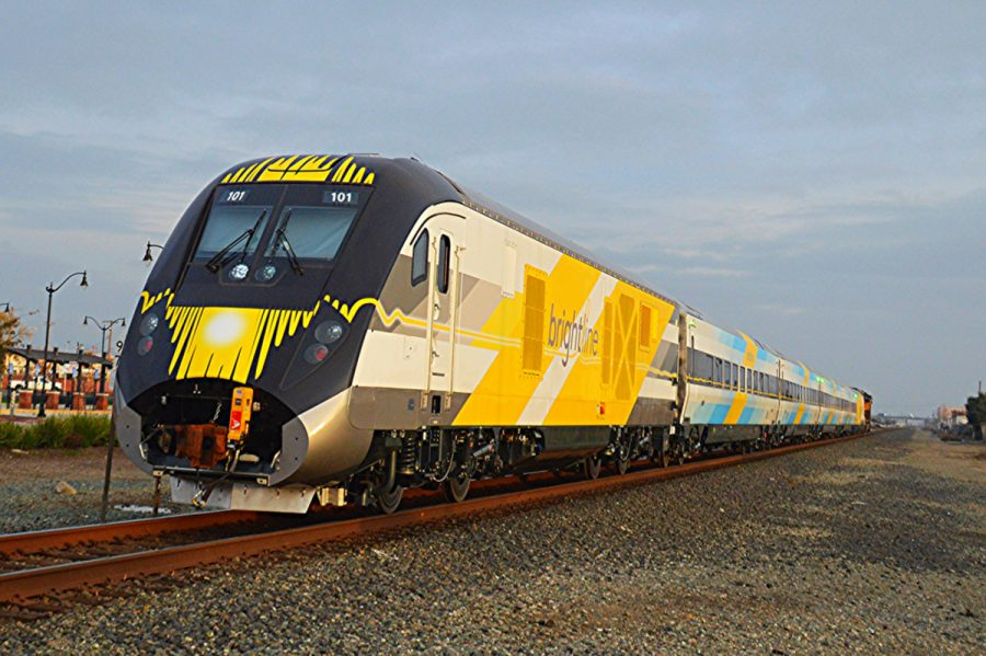 Brightline%E2%80%99s+blue+train+set+rolls+down+the+track%2C+the+first+of+several+other+Siemens+Charger+diesel+locomotive+and+passenger+coaches+that+will+be+part+of+the+company%E2%80%99s+fleet%2C+which+currently+operates+20+daily+trips.+