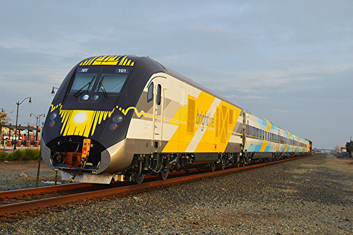 Brightline's blue train set rolls down the track, the first of several other Siemens Charger diesel locomotive and passenger coaches that will be part of the company's fleet, which currently operates 20 daily trips.
