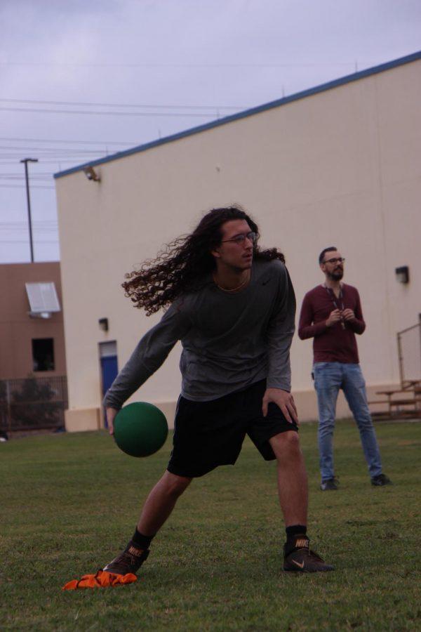 Visual senior Dalton Nellgar concentrates on pitching to the teacher team.