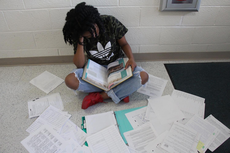 Digital media freshman Sydney Lavette studies for her semester exams. Lavette said she felt the pressure of an extensive work overload.