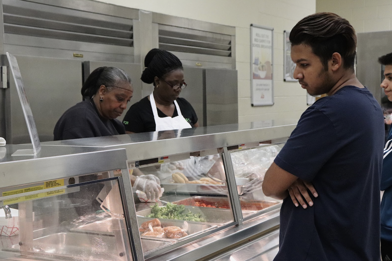 Visual Art senior Brandon Kainth contemplates which food to choose while waiting in the lunch line. The cafeteria staff served students throughout all of lunch and in the morning for breakfast, beginning at 7:30 a.m.