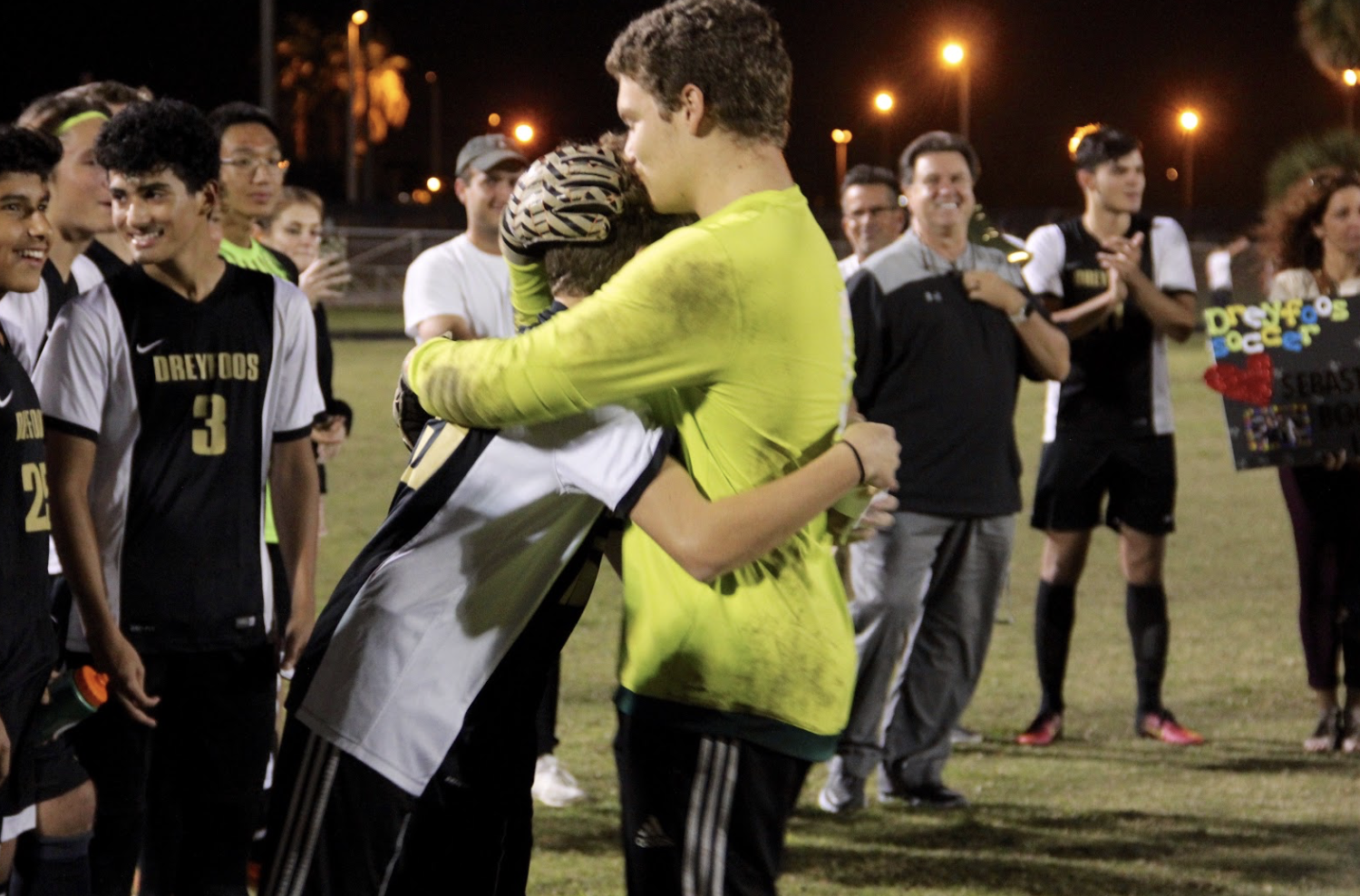 "Communications senior Skyler Buitrago embraces his younger brother, band freshman Nico Buitrago, after Nico delivered a tear-jerking speech thanking his brother for their most memorable times together growing up. As Skyler and other seniors on the team prepare to graduate, a special ceremony was held at their final regular season game, where families and fellow players honored the seniors. ""Playing with Nico was great,"" Skyler said. ""We're at the age gap where I wasn't in middle school with him so I only get this one year in school with him before I head out. I'm going to keep working with him and pushing him because he's an amazing athlete, and he will see that very soon. I'm so glad that my for my last year at Dreyfoos I was able to spend the season with him by my side."""