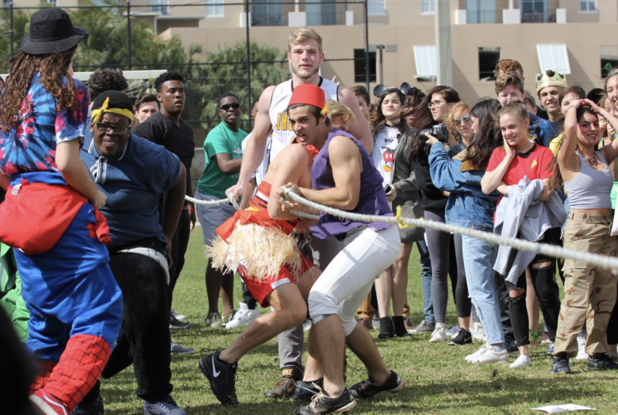 Visual senior Aaron Crawford and strings seniors Allen Cadet and Thomas Devito lead their team to victory during the tug o' war competition at the end of lunch. The senior team first competed against the sophomores, and later the juniors to secure their win at the end of the match.