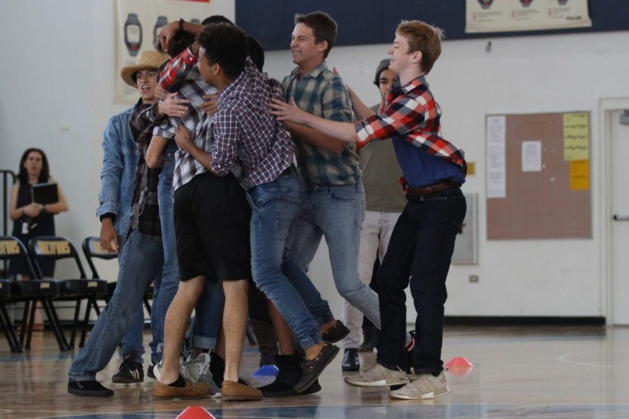 The freshmen dodgeball team celebrate defeating the junior class. Advancing to the final round against the seniors, the freshmen later lost, placing second in the tournament.