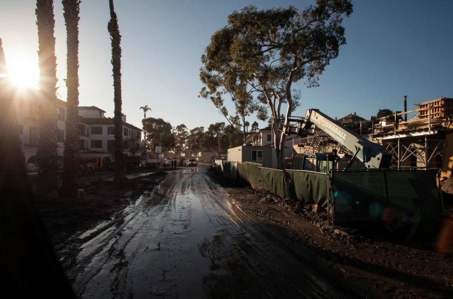 Mud+covers+roadways+in+Montecito%2C+California%2C+Jan.+11%2C+following+a+mudslide+earlier+in+the+week.+Deep+mud+has+left+some+areas+cut+off+from+critical+services%2C+and+residents+who+sheltered+in+place+during+a+storm+earlier+in+the+week+need+to+leave+their+homes.+California+National+Guard+high+water+vehicles+helped+transport+residents+from+neighborhoods+that+are+cut+off+to+a+centralized+drop-off+point+where+they+can+be+picked+up+or+taken+to+an+evacuation+center.+