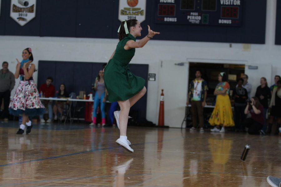 Dance sophomore Rachel Abelenda jumps to the beat of 60s tunes during the Generation Dance.  Abelenda not only participated in the Generation Dance and Pep Rally Dance, but choreographed Pep Rally as well.
