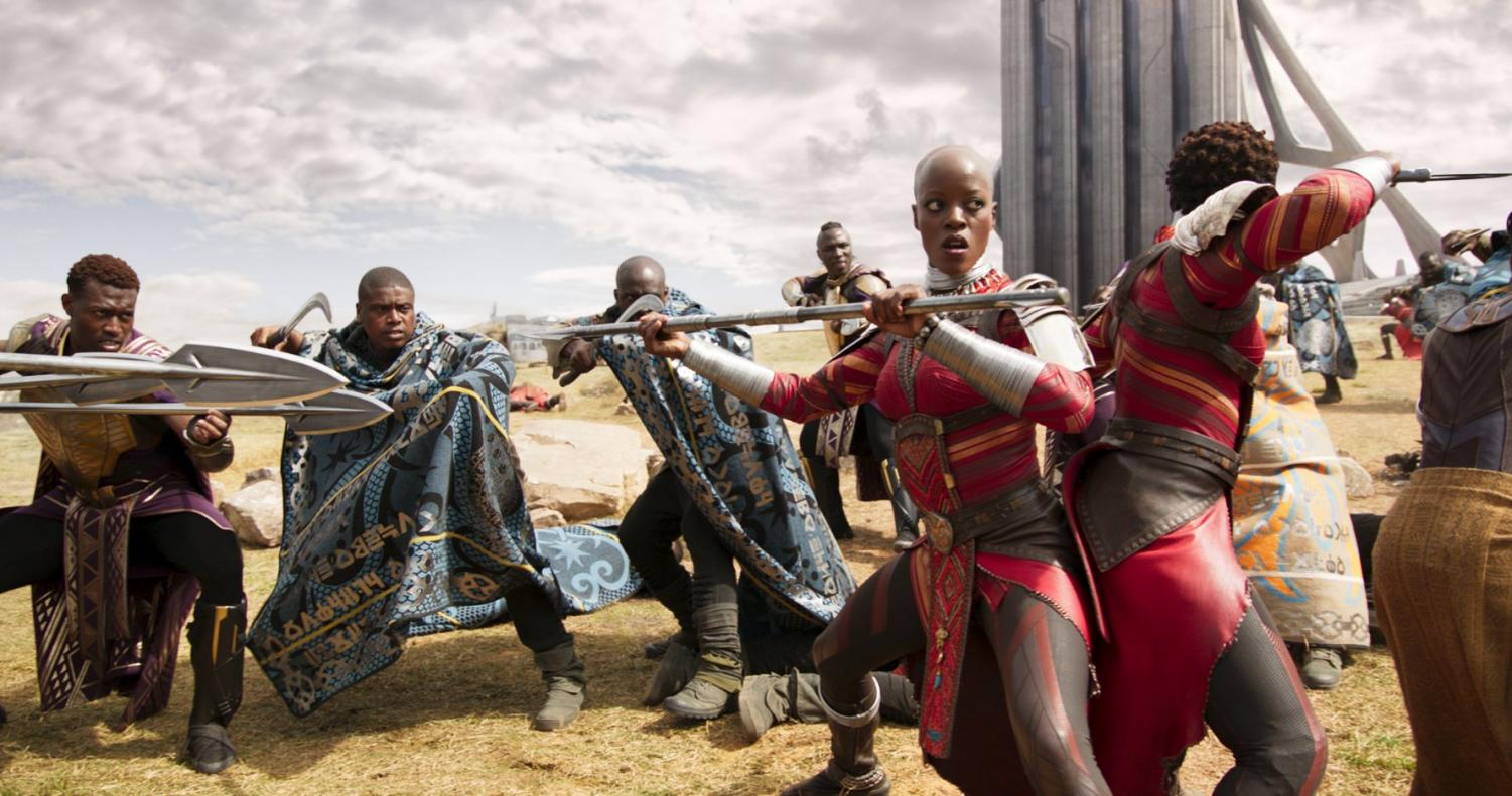 The Warriors of Wakanda stand tall in a fierce battle to defend their nation. As they wield modern weapons of war, they are dressed in garb true to their culture.