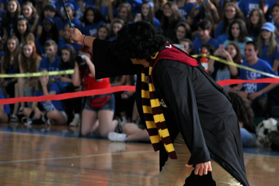 Mr. Mora triumphantly raises his wand as he fights off the death eaters in the senior's Pep Rally skit. The skit was directed by theatre senior Ethan Izenwasser, who took inspiration from the Harry Potter fight scenes to direct it.