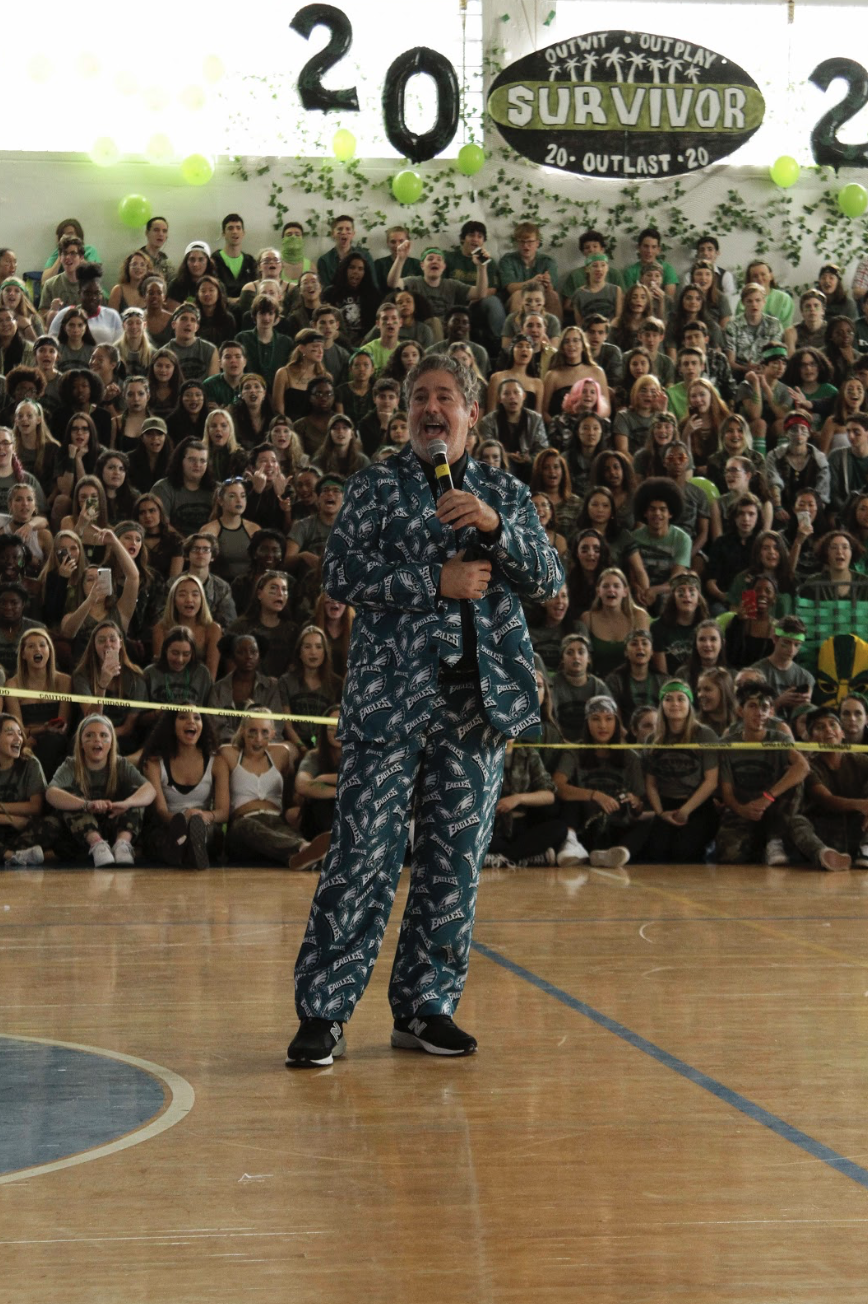 "Assistant Principal George Miller leads a Philadelphia Eagles cheer during Pep Rally on Feb. 2. Mr. Miller wore his iconic Eagles suit in preparation for going to the Super Bowl. ""[Going to the Super Bowl was a] once in a lifetime experience,"" Mr. Miller said. ""The best part of all of it was being there."""